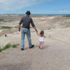 My Granddaughter leading me off into the South Dakota desert – I'm looking out for snakes!